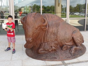Connor wanted to take a picture by himself with his bison that he had just bought from the gift shop.