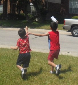 Here the boys are chasing after some bubbles that floated away.