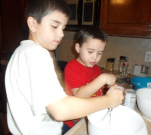 First the boys whisked together the dry ingredients...flour, baking powder, and salt.