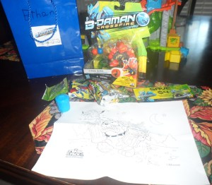 Contents of Each Gift Bag: B-Daman figure, B-Daman coupon, B-Daman Thunder Dracyan Card, Fruit Snacks, 2 Pack Trash Pack, Single Trash Pack, & Trash Pack Coloring Page