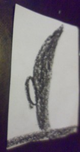 This is supposed to be a sword.  It wasn't in the book or in his drawing but he wanted it to be one of the pictures.