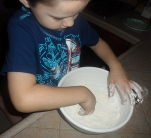 He mixed with his hands.