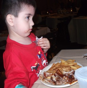 Connor had one of his favorite foods- ribs. He also got a sheriff's badge. I don't remember what I ate; I'm sure it was steak. I do remember that it was good though.