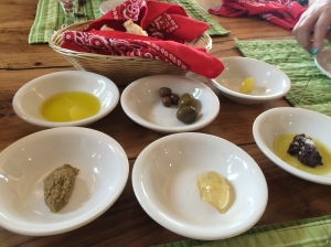 Starting from the top we have: Olive Oil, Olives, Olive Butter, Olive Pesto, Olive Leaf Jelly, and Olive Tapenade